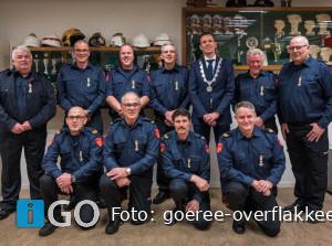 Tien brandweermannen Goeree-Overflakkee Koninklijk onderscheiden