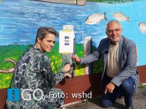Waterschap onthult muurschildering kunstenares Ida over zwerfafval