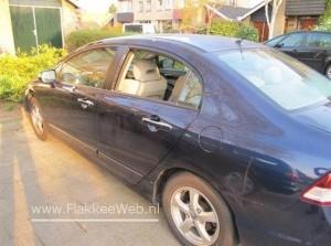 Inbraak in auto met veel schade