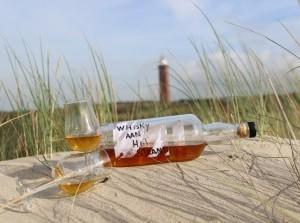 Whisky aan het strand bij Werelds